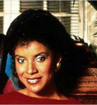 Phylicia Rashad with a demure smile